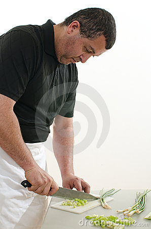 Attractive latin american man cooking