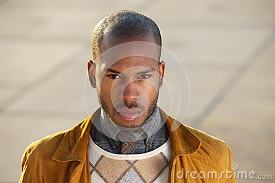 Attractive male fashion model looking at camera