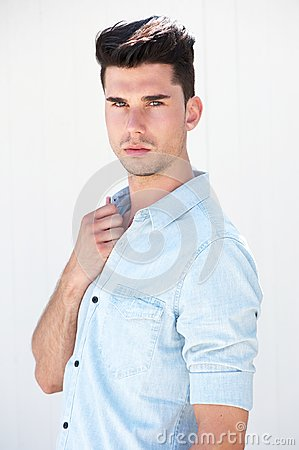 Attractive male fashion model standing on white background
