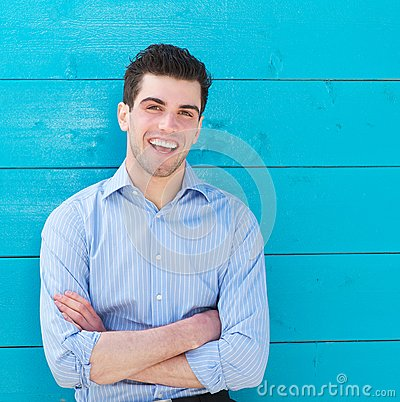 Attractive male model laughing outdoors