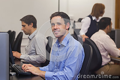 Attractive male student sitting in computer class