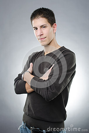 Attractive man with arms folded