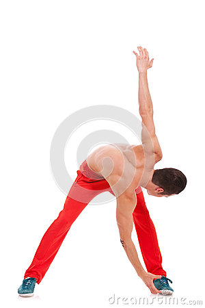 Attractive man athlete warming up