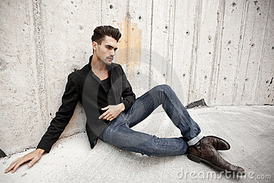Attractive man dressed in jeans and boots