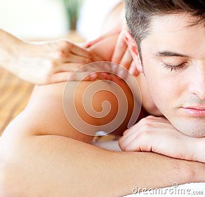 Attractive man having a back massage