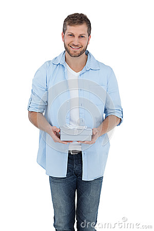 Attractive man holding a gift looking at camera