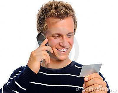 Attractive man reading out credit card number