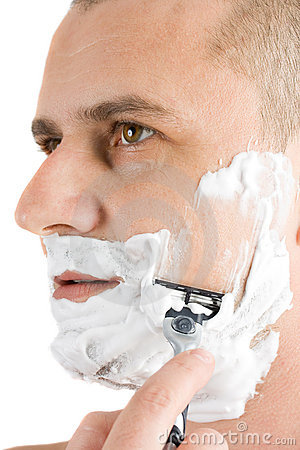Attractive man shaving