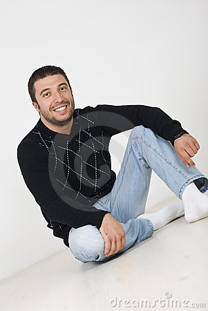 Attractive man sitting on floor