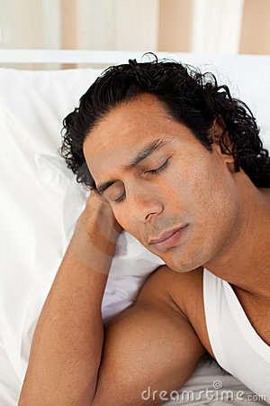 Attractive man sleeping on the bed