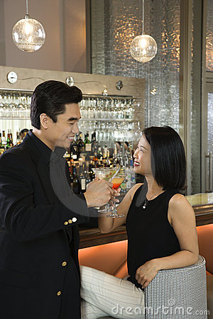 Attractive Man And Woman At Bar Having Cocktails Stock Images - Image: 12753724
