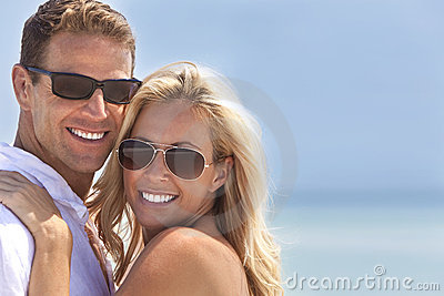 Attractive Man & Woman Couple Happy At the Beach