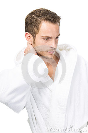 Attractive masculinity in bathrobe - isolated