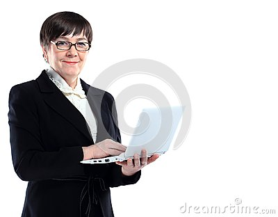 Attractive mature business woman with laptop