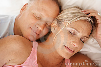An Attractive Mature Couple Sleeping Together