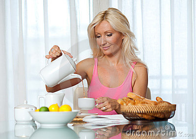 Attractive mature woman at breakfast