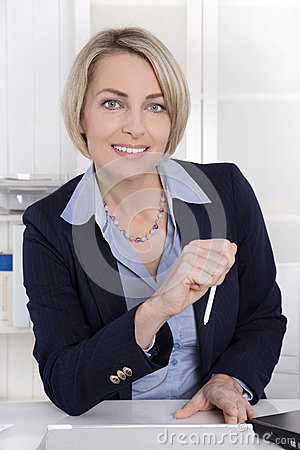 Free Attractive Middle Aged Woman In Business Outfit Sitting In Her O Stock Photos - 44679973