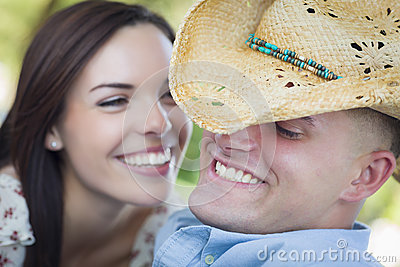 Attractive Mixed Race Couple with Cowboy Hat Flirting