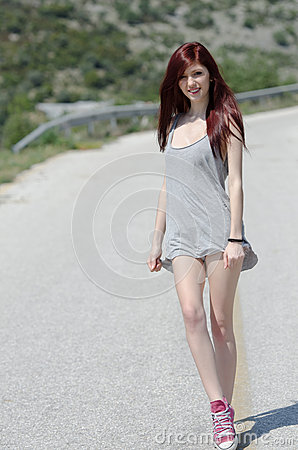Free Attractive Model Standing In The Middle Of A Mountain Road Royalty Free Stock Photography - 62066407