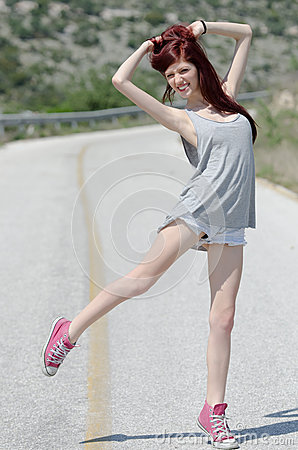 Free Attractive Model Standing In The Middle Of A Mountain Road Stock Photos - 62066873