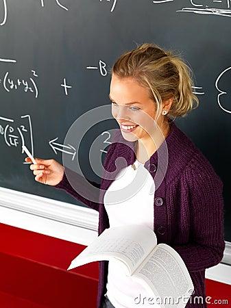 Attractive modern teacher teaching math