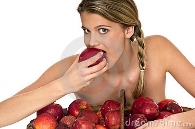Attractive naked woman tasting a juicy red apple