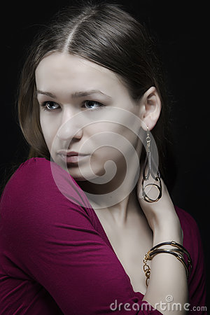 Attractive natural face woman with earring portrait