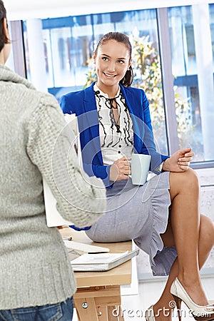Attractive office girl on coffee break