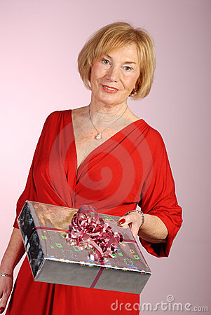 Attractive older woman holding a gift