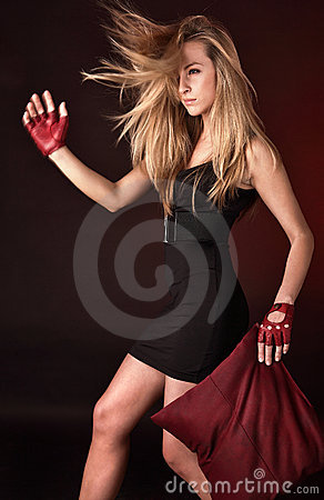 Attractive posing blonde in a red sport gloves