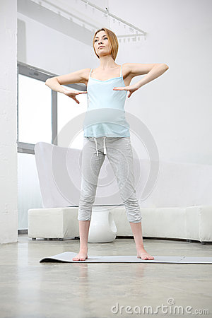 Attractive pregnant woman exercising