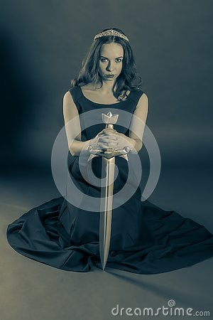 Free Attractive Princess Girl Kneeling With A Sword Royalty Free Stock Photography - 129602647