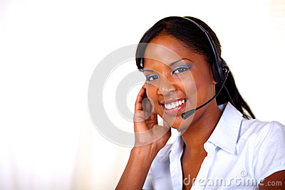 Attractive receptionist smiling and looking at you