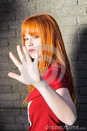 Girl showing handful as stop sign