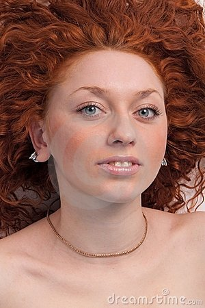 Attractive red haired woman close up.