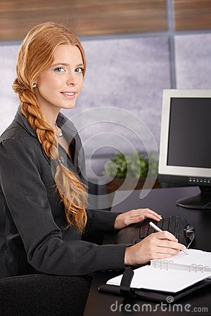 Attractive Redhead Businesswoman At Work Royalty Free