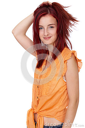Attractive redhead girl in orange shirt, isolated