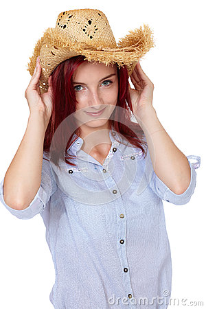 Attractive redhead girl with straw hat, isolated
