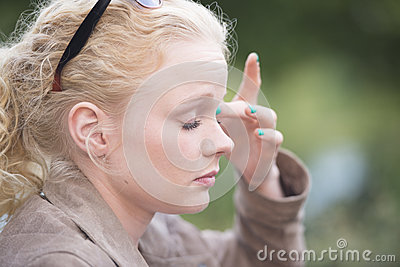 Attractive relaxed young blond woman