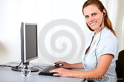 Attractive secretary smiling on callcenter