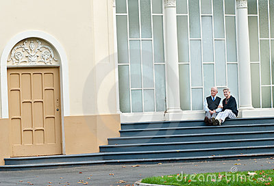 Attractive senior couple on steps