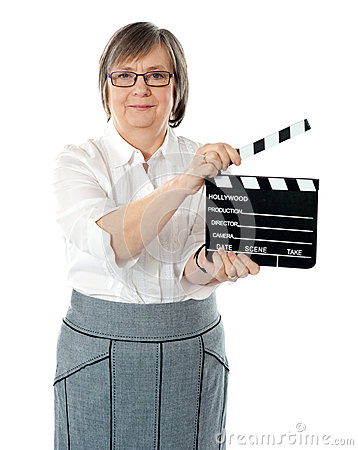 Attractive senior woman using clapperboard