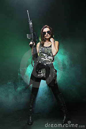 Attractive And Sexy Army Girl With Assault Rifle Stock