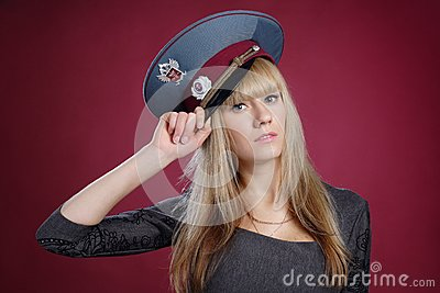 Attractive sexy blond woman in service cap