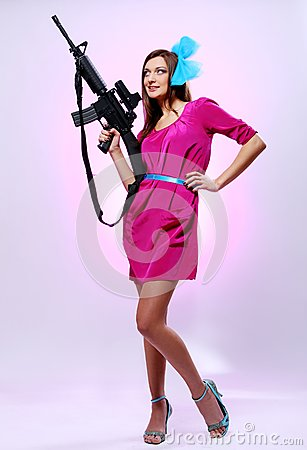 Attractive and sexy spy woman with assault rifle