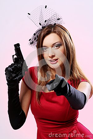 Attractive and sexy spy woman with pistol