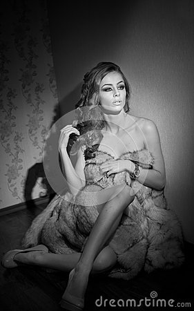 Free Attractive Sexy Young Woman Wrapped In A Fur Coat Sitting In Hotel Room. Black And White Portrait Of Sensual Female Daydreaming Stock Photo - 44026880