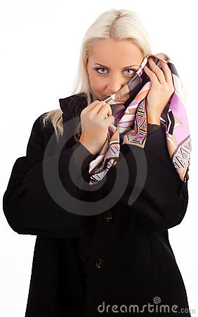 Attractive shy woman wearing coat