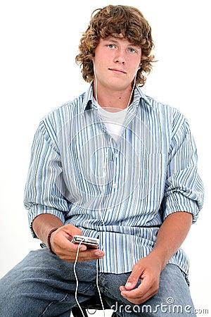 Free Attractive Sixteen Year Old Teen Boy Listening To Headphones Stock Photos - 193103