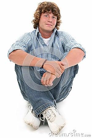 Attractive Sixteen Year Old Teen Boy Sitting On Floor